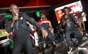 In this photo taken Wednesday, April 6, 2016, members of the Kenyan music group Sauti Sol, from left to right, Bien-Aime Baraza, Savara Mudigi, and Willis Austin Chimano, perform at an event in Nairobi, Kenya. Not many musicians can boast they've made President Barack Obama get up and groove to their tunes but Kenyan band Sauti Sol did just that with their mix of Afro-pop, soul and R&B, which has won a number of international awards. (Ben Curtis/Associated Press)