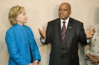 File Picture:U.S. Secretary of State Hillary Clinton (L) watches as South Africa's President Jacob Zuma speaks during a photo call after a brief meeting in Durban, August 8, 2009