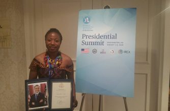 KYENG MERCY TETUH poses with her YALI Certificate delivered in Washington,DC. Mercy was part of a town hall meeting between President Obama and the YALI Fellows