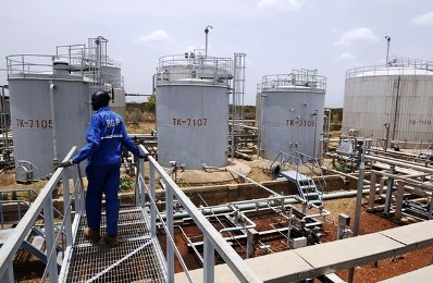 A-worker-walks-at-the-power-plant-of-an-oil-processing-facility-at-an-oilfield-in-Unity-State