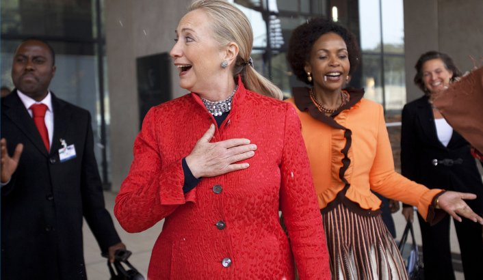 U.S. Secretary of State Hillary Clinton (2nd L) and South Africa's Foreign Minister Maite Nkoana-Mashabane (2nd R) react to a rare snow flurry as they leave business meetings in Pretoria August 7, 2012. REUTERS/Jacquelyn Martin