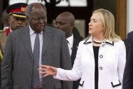 """1.US Secretary of State Hillary Clinton meets with Kenyan President Mwai Kibaki at the State House in Nairobi. Clinton has urged Kenyans to work together to ensure """"transparent"""" elections next year and avoid a repeat of the deadly post-poll violence four years ago. Clinton has urged Kenyans to ensure """"transparent"""" elections next year and avoid a repeat of the post-poll violence four years ago. (AFP Photo/Jacquelyn Martin)"""