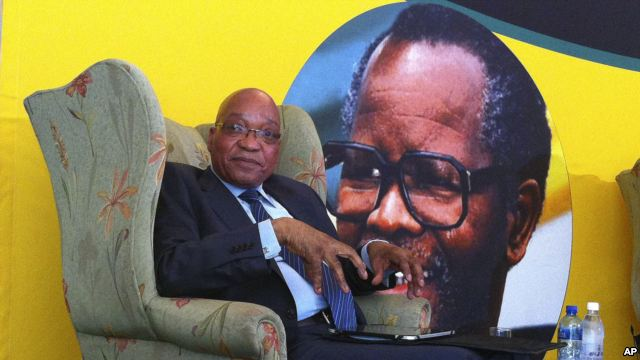 South African president Jacob Zuma, in front of a portrait of former African National Congress president Oliver Tambo, addresses foreign correspondents at a breakfast in Johannesburg, Oct. 29, 2012