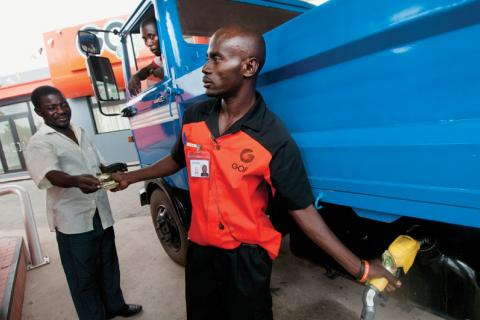Filling a truck with diesel fuel at a Ghana Oil station in Accra: One of Africa's newest oil producers, Ghana has put into place laws and institutions to help ensure that oil revenues are not wasted or diverted, but benefit the country's development.