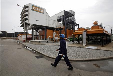 A man walks in front of a plant of Ivory Coast power company Ciprel in Abidjan in this June 12, 2012 file photo. 
