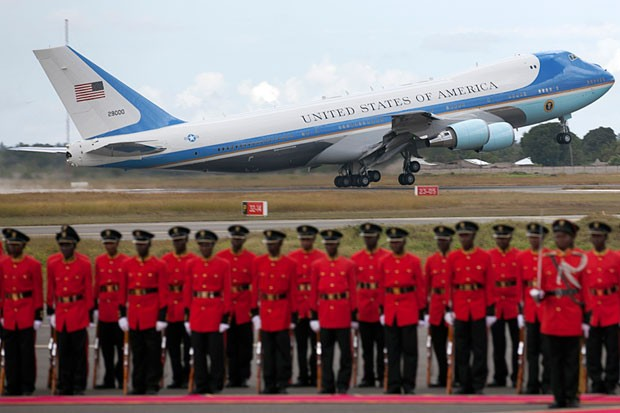 Air Force One takes off as a Tanzanian honor guard stands to attention at the Julius Nyerere airport on Tuesday, Juy 2, 2013, in Dar es Salaam, Tanzania. (Ben Curtis/AP)