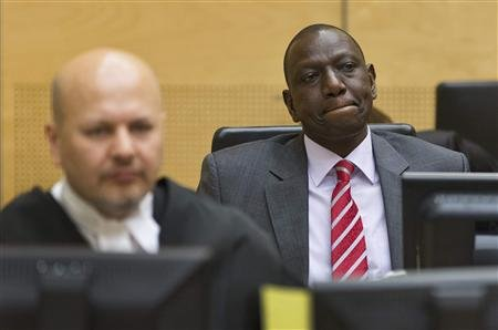 Reuters/Reuters - Kenya's Deputy President William Ruto (R) reacts as he sits in the courtroom before his trial at the International Criminal Court (ICC) in The Hague in this September 10, 2013 file photo. REUTERS/Michael Kooren/Files