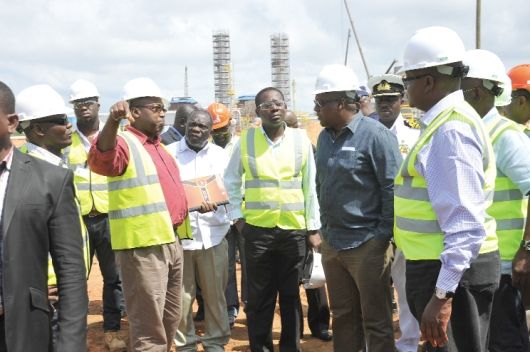 Dr Ben Asante, Technical Director of the project, briefing President Mahama and his entourage on the progress of work at the project site. Picture EBOW HANSON
