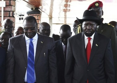 (From L-R) South Sudan's Vice-President Riek Machar and President Salva Kiir pay their respects at John Garang's Mausoleum, during the celebration of the 2nd anniversary of South Sudan independence, in Juba, July 9, 2013. (Reuters/Andreea Campeanu)