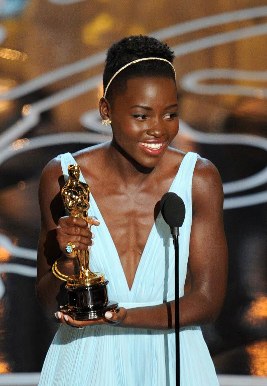 Lupita Nyong'o accepts her Oscar. (Pic: AFP)