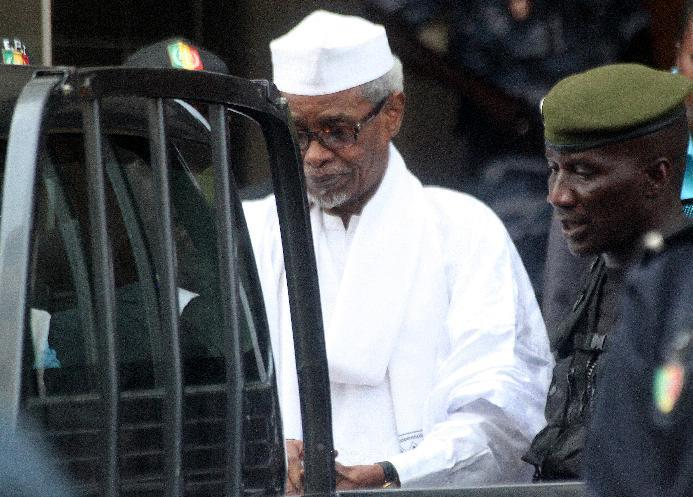 Former Chadian dictator Hissene Habre is escorted by military officers after being heard by judge on July 2, 2013 in Dakar, Senegal (AFP Photo/)