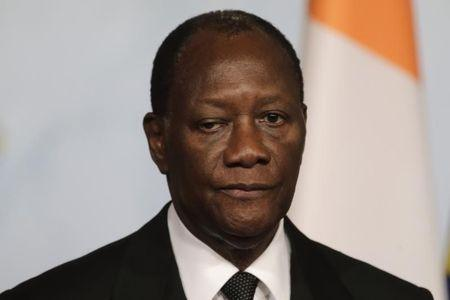 Ivory Coast's President Alassane Ouattara attends a news conference at the Elysee palace in Paris, December 4, 2014. REUTERS/Philippe Wojazer