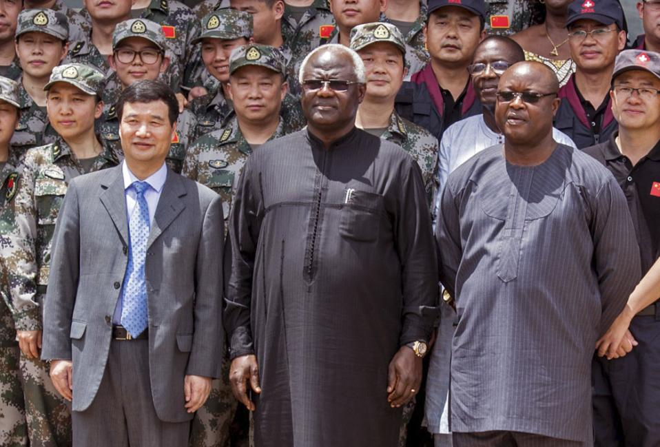 In this photo taken on Sept. 25, 2014, Chinese Ambassador Zhao Yanbo, center left, stands next to Sierra Leone's President Ernest Bai Koroma, center, and Sierra Leone's Vice President Samuel Sam-Sumana, centre right, during the opening ceremony of the China Friendship Hospital catering for Ebola virus patience in Freetown, Sierra Leone. Sierra Leone's vice president has put himself in quarantine following the death from Ebola of one of his security guards. Sam-Sumana voluntarily decided to quarantine himself for 21 days following the death from Ebola last Tuesday Feb. 24, 2015, of one of his security personnel, according to a report issued late Saturday, Feb. 28, 2015, by the Sierra Leone Broadcasting Corporation. (AP Photo/ Michael Duff)