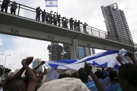 Protesters, mainly who are Israeli Jews of Ethiopian origin, block a main road in Tel Aviv during a demonstration against what they say is police racism and brutality, after the emergence last week of a video clip that showed policemen shoving and punching a black soldier May 3, 2015. REUTERS/Baz Ratner