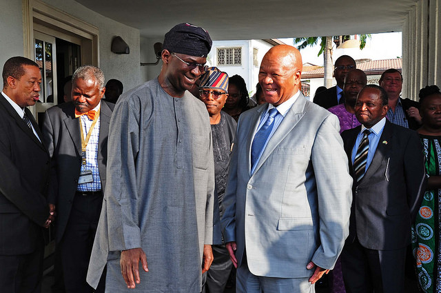 Babatunde Fashola (left) meets South African minister, Jeff Radebe (right). Photograph by GovernmentZA/DoC.
