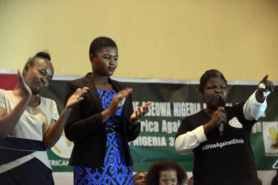 Ebola virus survivors including Dr. Ada Igonoh (C) speak to volunteer Nigerian health workers on a mission to fight the Ebola virus in affected West African countries, in Lagos on December 3, 2014 (AFP Photo/Pius Utomi Ekpei)