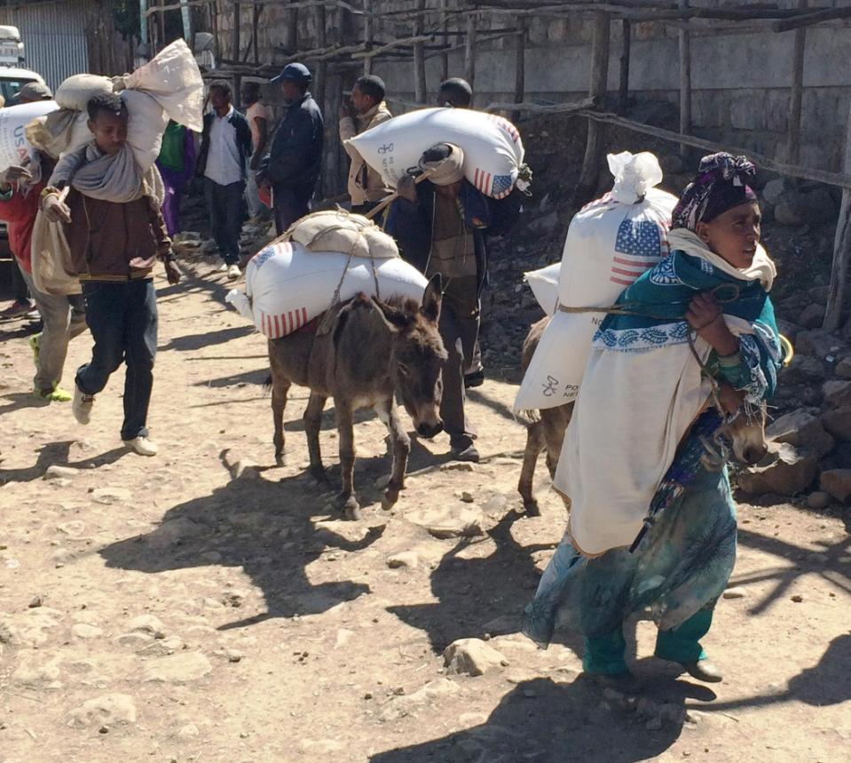 In this photo of Monday Dec. 14, 2015 families begin their journey home from the Estayesh Food Distribution Site in Denkena Kebele, Meket Woreda, Ethiopia. The United States government has announced $88 million to help feed hungry people in drought affected areas of Ethiopia, bringing the total number of humanitarian aid provided to the country in 2015 to more than $435 million. The announcement came as the Ethiopian government is appealing for $1.4 billion from the international community and donors to help feed more than 10 million people. (AP Photo/David R. Kahrmann) .  --