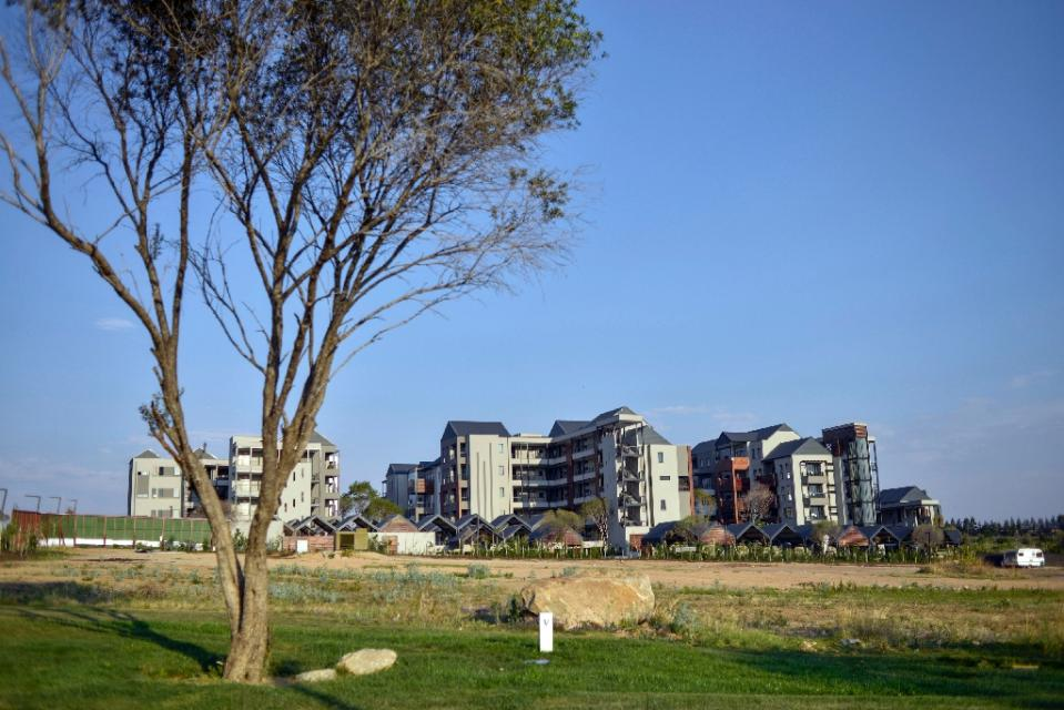 "Steyn City's developers say it will cater for many ordinary middle-class families of all races, and could become a flagship for future new cities in Africa Green, tidy, with safe public areas and winding bicycle paths -- Steyn City is a vast ""self-sufficient"" development outside Johannesburg that highlights growing controversy over South Africa's divided urban society. (AFP Photo/Mujahid Safodien)"