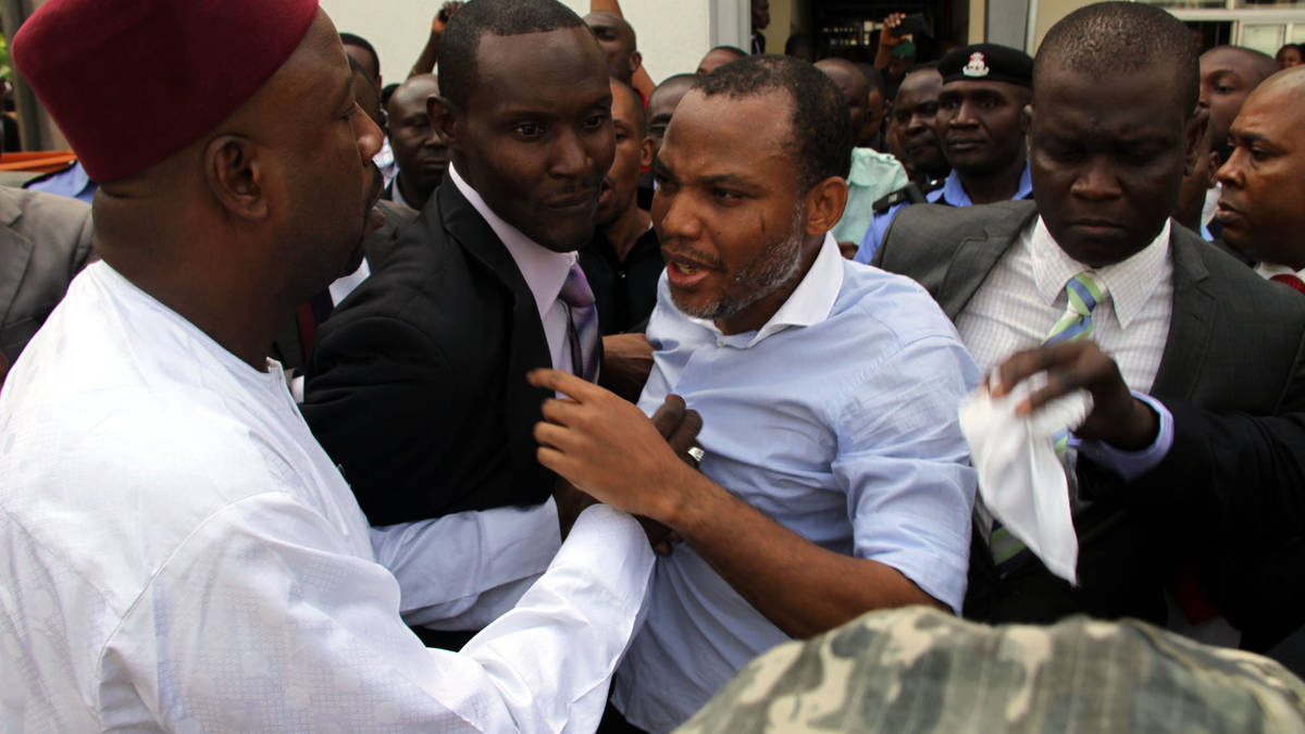 Director of Radio Biafra, Nnamdi Kanu, sandwiched between security operaives, leaving the court  in Abuja recently