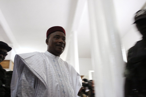 Niger President Mahamadou Issoufou prepares to cast his ballot during elections in Niamey, Niger, Sunday, Feb 21, 2016. Voting has begun in the West African nation of Niger, where Issoufou is touting his record of defending the country from Islamic extremists as he vies against 14 other candidates for a second five-year term.