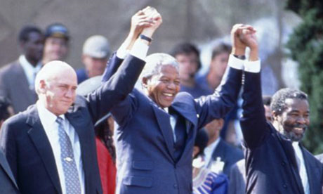 Nelson Mandela at his presidential inauguration with his deputies, FW de Klerk and Thabo Mbeki. Photograph: Photoshot