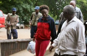 FILE - Zimbabwean human rights activist, Jestina Mukoko (c) is led into court in Harare, Zimbabwe on Dec. 24, 2008.