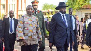 President Salva Kiir (R) welcomed the return of Riek Machar (L) to the capital