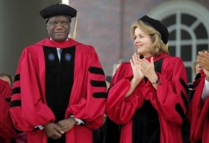 Soprano Renee Fleming (R) applauds as Denis Mukwege, head of the Panzi Hospital in the Democratic Republic of the Congo, stands to receive an honorary Doctor of Science degree during the 364th Commencement Exercises at Harvard University in Cambridge, Massachusetts May 28, 2015. REUTERS/Brian Snyder