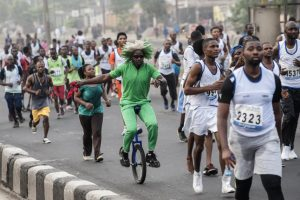 Nigerians participate in a marathon in Lagos, Nigeria, February 6. Lagos is one of three existing megacities—with populations of more than 10 million—in Africa, and more are expected to spring up in the coming decades. STEFAN HEUNIS/AFP/GETTY IMAGES