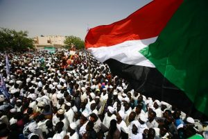 People gather to listen to a speech by Sudan's president during his visit to El Daein, in eastern Darfur, on April 5. (Ashraf Shazly/AFP/Getty Images)