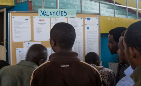 Photo: The New Times Jobseekers look for job opportunities on a notice board displayed (file photo).