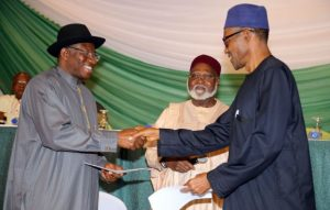 Nigerian President Goodluck Jonathan (left), and APC main opposition party's presidential candidate Mohammadu Buhari shake hands on March 26, 2015 in Abuja, ahead of the election. (Philip Ojisua/AFP/Getty Images)