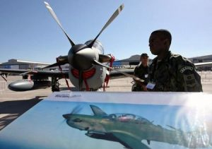 A Brazilian soldier stands guard near a A-29 Super Tucano during the opening ceremony of the Santiago's Aviation Fair, known as FIDAE, at Chile's international airport, file. REUTERS/Ivan Alvarado More