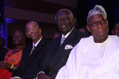 Angelle Kwemo in a file picture with Congressman Bobby Rush, John Kufuor former President of Ghana and Olusegun Obasanjo, former President of Nigeria