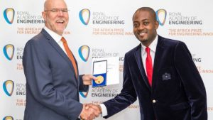 Mr Zang, right, received the prize at a ceremony in Dar es Salaam, Tanzania