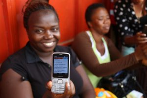 A nurse displays her text notification of mobile money in Freetown (@UNDP Sierra Leone)