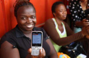 A nurse displays her text notification of mobile money in Freetown (@UNDP Sierra Leone)