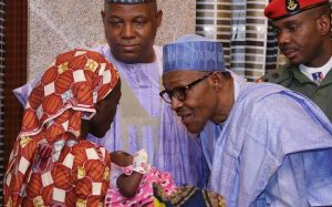 President Buhari with Amina, rescued recently and said to be one of the Chibok girls. The APC made the missing Chibok girls a political issue while in the opposition.A year after they took power, the girls have still not been found.
