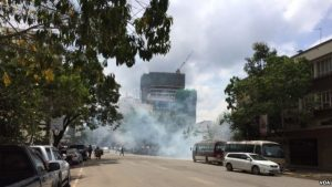 Riot police fire tear gas to disperse small groups of people gathering near the electoral commission headquarters in Nairobi ahead of a planned opposition demonstration that authorities said would be illegal, May 23, 2016. (J.Craig/VOA)