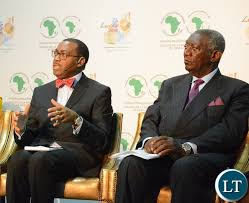 Bank President Akinwumi Adesina speaking whilst former President of Ghana John Kufuor listens at the Achieving Nutritional Security conference