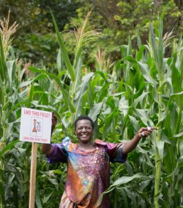 When One Acre Fund requested Elumuka Margaret to provide a small portion of her farm for maize planting demonstration, she was reluctant at first. Now her farm has become a centre of attraction in Busota village, Uganda, and she says she receives at least two visitors everyday interested in learning One Acre Fund's maize planting techniques. / Photo by Kelvin Owino