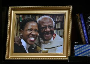 A photo of Mpho Tutu and her father, Desmond, sits on the bookshelf in her office in Alexandria, Va. (Carol Guzy for The Washington Post)