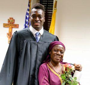 Michael Tertsea and his mom, Felicia Ikpum, at the Baccalaureate Mass. (Joseph Schuberth/John Carroll School)