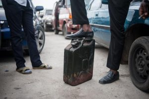 A man waits with his jerrican to buy fuel in Lagos, Nigeria, April 6. Nigeria has suffered a severe fuel shortage in recent months, with long queues developing outside gas stations. STEFAN HEUNIS/AFP/GETTY IMAGES