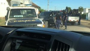 Congolese military and policemen surround Lewis' vehicle at political rally. OBTAINED BY JONES GROUP INTERNATIONAL