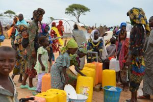 People look for drinking water in the Assaga refugee camp in southeast Niger, September 16, 2015. The camp was established by the U.N. to host Nigerians fleeing from violence perpetrated by Boko Haram. BOUREIMA HAMA/AFP/GETTY IMAGES