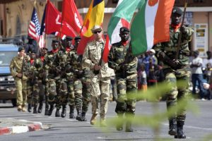 Soldiers parade during the closing ceremony of a joint military exercise between African, U.S. and European troops in Saint Louis, Senegal, February 29. The U.S. has signed an agreement increasing access to facilities in the West African country. SEYLLOU/AFP/GETTY IMAGES