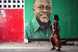 """Candidate John Magufuli looks out from an election billboard in Dar es Salaam, Tanzania's largest city. The former teacher and chemist took office as president in November and has pledged to fight corruption. His nickname: """"the bulldozer."""" Daniel Hayduk/AFP/Getty Images"""