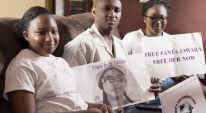 Fanta Darboe Jawara is being held in Gambia's notorious Mile 2 Central Prison while husband and children Sarah, 12, left and Aminata, 17, anxiously await her return to their Frederick, Md. home. Jawara, 45, a naturalized American citizen, had returned to her homeland for the first time in 11 years for a family reunion. Just as she was getting ready to head back to her husband and girls in Frederick, she was caught in a sweep of arrests at a government protest in Banjul, Gambia's capital. (Bill Green/The Frederick News-Post via AP) The Associated Press