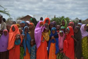 TONY KARUMBA VIA GETTY IMAGES Refugees gather to watch the arrival of United Nations High Commissioner for Refugees Antonio Guterres at IFO-2 complex of the sprawling Dadaab refugee camp on May 8, 2015. Dadaab refugee camp currently houses some 350,000 people and for more than 20 years has been home to generations of Somalis who have fled their homeland wracked by conflicts. But Kenya's government asked the UN refugee agency (UNHCR) to close the camp after an attack on Kenyas Garissa University by Somalia-based Al-Shabaab gunmen in April, whom are suspected to have planned and launched their attack from the camp. AFP PHOTO / TONY KARUMBA